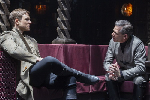 Robin (Taron Egerton, left) and Sheriff (Ben Mendelsohn, right) in ROBIN HOOD. Photo by: Larry Horricks.