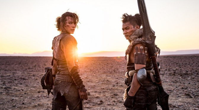 """(L-R) """"""""ARTEMIS"""""""" (Milla Jovovich) and """"""""HUNTER"""""""" (Tony Jaa) on set in Screen Gems and Constantin Films' MONSTER HUNTER."""