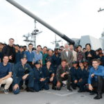 HONOLULU, HAWAII - OCTOBER 20: Cast and crew from the film Midway stand with a group of sailors aboard the USS Halsey on October 20, 2019 in Honolulu, Hawaii. (Photo by Marco Garcia/Getty Images for Lionsgate Entertainment)